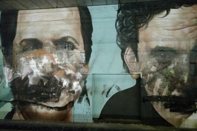 Il murales imbrattato di Massimo Troisi e Alighiero Noschese